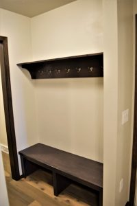 Bench with hooks by garage entry